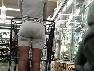 Candid slim ebony bubble butt, VPL posing in line.